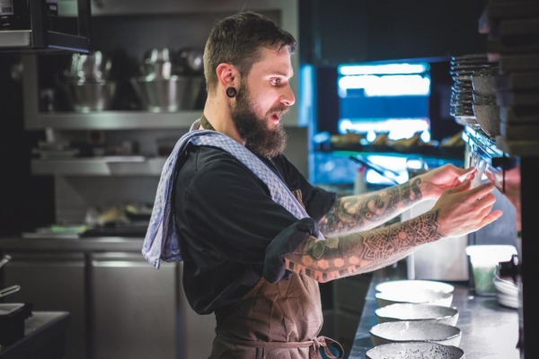 chef with tattoo